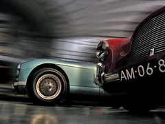 the race (GodMadeMeFunky) Tags: auto blue red motion blur classic cars car race speed germany deutschland drive fotografie ride dynamic angle x bewegung vehicle oldtimer motor autos strase dusseldorf dsseldorf rennen challenge astonmartin perspektive digest fahrzeug araba carphotography fahrzeuge meilenwerk britishsportscar dynamik klassiker  almanya