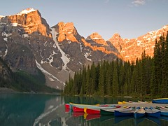 Crayon Canoes (Matt Champlin) Tags: life morning blue red canada mountains color reflection nature sunrise landscape still bravo colorful hiking canoe boating banff stillframe moraine banffnationalpark morainelake canadianrockies keepexploring