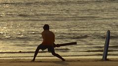 Beach Cricket Goa (the_steve_cox) Tags: sunset people india man beach ball bristol play goa cricket surfboard leela hitting coxy stevecox photoportunity photoportunitycom