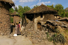 Houses of Lalibela (Eileen Delhi) Tags: africa house stone women thatch ethiopia lalibela vanishingbeauty