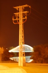 Electric tower against the bridge (ManuelChao [ MoMoChao / ManuChao]) Tags: bridge light espaa bus tower luz night ro puente lights noche calle movement poste farola glow torre shadows shine place carretera perspective loco movimiento seis farol logroo autobus rioja sobre larga espaol brillo redonda exposicin