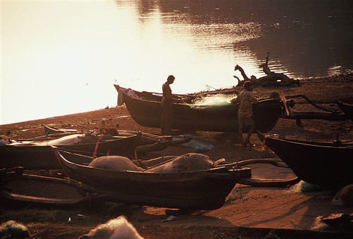Boatmen at work in the evening, Goa