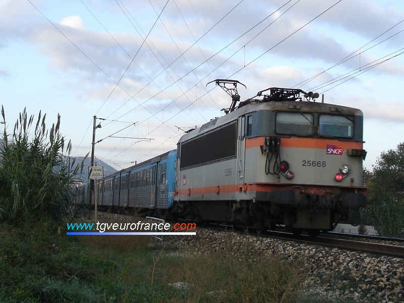 A BB25500 electric locomotive with the new SNCF logo on a push-pull service towards the station of La Penne-sur-Huveaune
