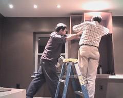 Kitchen cabinets getting installed