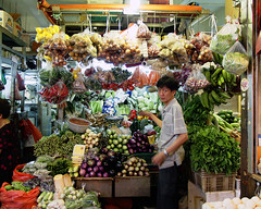 Vegetable Seller (espion) Tags: portrait vegetables retail iso200 singapore market space stall tiny littleindia cramped 500v 115 tekka f35 e500 zd 14mm 1445mm