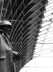 I only recently noticed the Paddington Station memorial - commemorates Railway employees who fought in WW2 (Shamus O'Reilly) Tags: uk england blackandwhite bw london station statue architecture train reading book memorial war wwii railwaystation londres paddington rib londra londen solider
