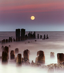 Moonrise (James Jordan) Tags: longexposure topf25 water wow pier bravo quality 100v10f moonrise soe movingwater magicdonkey 50faves outstandingshots abigfave perfectangle p1f1 cotcbestof2006 platinumphoto 30faves30comments300views anawesomeshot colorphotoaward impressedbeauty superbmasterpiece 50earthfaves 100earthcomments bestcaptureaoi winnerbc