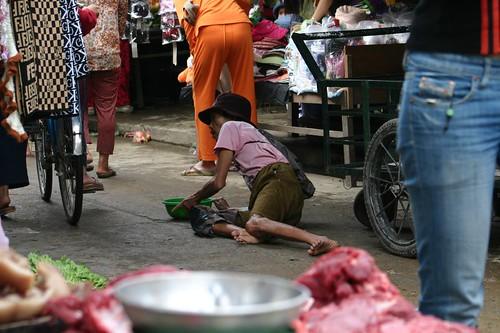 Beggar. Hoi An local market.