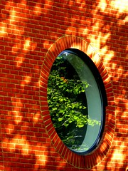(fourcotts) Tags: light red reflection brick green window nature leaves wall view gorgeous sparkle explore round peek shaw newbury speckles fourcotts