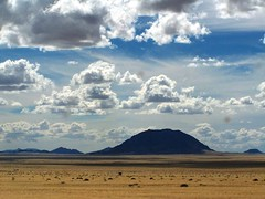 Namibian Landscape (geoftheref) Tags: africa travel sky mountain clouds de landscape la interestingness interesting flickr wolke paisaje paisagem il safari afrika nuage nuvem paysage landschaft namibia nube paesaggio landschap wolk  frica namibie lafrique namibi  geoftheref nambia dellafrica  afrikasafari