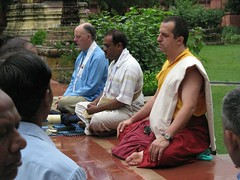 Subhuti meditating with monk and others