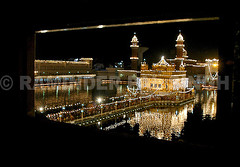The Illuminated Golden Temple (Raminder Pal Singh) Tags: lighting india black reflection water yellow temple lights faith religion towers decoration illumination belief sikhs punjab spiritual amritsar sikhism goldentemple decorated thepca harimandarsahib
