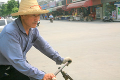 IMG_0532 (Sam's Exotic Travels) Tags: guangzhou china street people man hat bicycle sam straw sams changan travelphotos samsays samsexotictravelphotos exotictravelphotos samsayscom