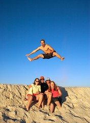 Family Portrait (hrtmnstrfr) Tags: family vacation portrait liz beach muscles mom fly flying george jump dad air caroline bluesky 2006 ups abs height splits sauter perdidobeach