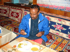 Bharat eating his Daal Bhaat (Andreas' Photos) Tags: nepal khumbu khumjung