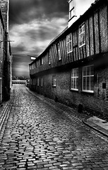 Looking back in time 1 (James Rye) Tags: uk england bw white black heritage history james noir time unitedkingdom sinister norfolk olympus cobbled rye warehouse lynn kings trading blank lane cobbles trade bianco middleages nero guild kingslynn hanseatic e500 lookingbackintime cm090 jamesrye flickrplatinum