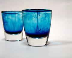 oh so blue! (elizabethboyajian) Tags: blue color water glass studio high key experimental dof shot highkey dye shotglass shotglasses fooddye experiement