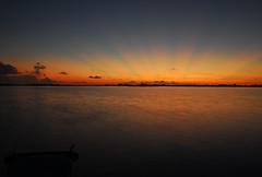 Belize sunset (Orlando Wedding Photographer Lori Barbely) Tags: ocean sunset sky orange sun water sunrise catchycolors ray belize sunbeam sunbeams centralamerica belize2006