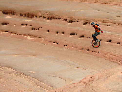 Mountain unicycling, Bartlett Wash slickrock, Moab, Utah