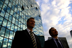 allez business! (maybemaq) Tags: blue portrait sky cloud man paris france reflection guy window smile businessman friend meeting business suit businessmen