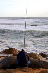 Sunset fishing (Mario 2R's) Tags: light sunset sea beach portugal water fisherman sand rocks waves cap oporto nikonstunninggallery