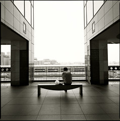 ... (_rin_) Tags: light shadow bw man 6x6 film rain station japan architecture dark person kyoto wideangle hasselblad squareformat photoart ilford bldg biogon 903swc xp2super