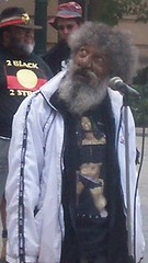 Adrian Walker gazes at Casino Towers, the building that used to hold the hated Native Affairs department - Justice for Mulrunji Rally at Queens Park and March through Brisbane City, Australia, November 18 2006