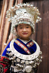 Little Miao girl in traditional costume (kevinlamphoto) Tags: china travel portrait girl smile silver costume kid asia village child silverware traditional chinese environmental ornament guizhou miao langde ethnic minority hmong minorities longde travelerphotos