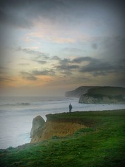 Lonely as a cloud?  - Freshwater Bay Landscape, Isle of Wight (s0ulsurfing) Tags: sunset sea sky cliff cloud seascape water beautiful grass misty clouds danger composition wonderful spectacular landscape bay chalk interestingness interesting fantastic bravo perfect rocks poetry waves mood colours superb wind pastel gorgeous awesome salt foggy wave atmosphere windy down 2006 literature cliffs salty foam edge isleofwight stunning getty dreamy title entitled awe isle cloudscape atmospheric wight caspar freshwater friedrich wordsworth outstanding tedious tennyson tenuous freshwaterbay s0ulsurfing lonelyasacloud