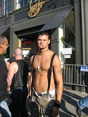 Smokin' (frankfarm) Tags: sanfrancisco shirtless jockstrap man male men guy jock leather tattoo pants cigarette piercing smoking camo camouflage suspenders smoker folsomstreetfair dogtags unzipped