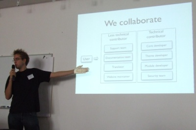 picture of a person presenting with a we collaborate slide