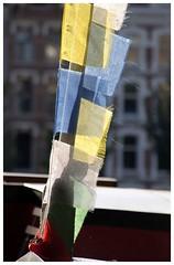 Lhasa? (Gurugo) Tags: sun netherlands amsterdam buddhist banner nederland holanda tibetan amesterdo utatacolorblack utatainhalf wesperzijde