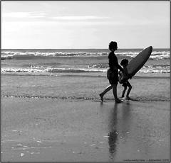 Never too young ...... (reallyreallyrosie) Tags: uk family boy sea two england bw beach photoshop fz20 waves child board pair surfing artsy mum devon bantham postprocessing