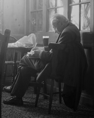 The Quiet Pint (Monster.) Tags: portrait bw man beer reading reflecting book pub inn chair bravo sitting shadows seat relaxing drinking ale oldman thinking resting pint seated gentleman softlight iow warships carrierbag imbibing