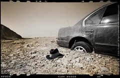 Fedora, After the Flood (Sen Duggan (aka f/1.4)) Tags: california abandoned film hat car mystery sepia mediumformat desert flood f14 pinhole deathvalley fedora ambiguity zeroimage incongruous flashflood abandonedcar zero69 aftertheflood artifactsofanuncertainorigin