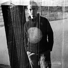 Winter (Aeioux) Tags: door uk bw sunlight selfportrait film me topv111 standing mediumformat birmingham exposure factory bright doubleexposure double lubitel eastside stef frowning digbeth aeioux aeiouxbirminghamuk