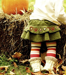 Striped tights and a pumpkin (*Pretty in Pink*) Tags: autumn fall halloween leaves pumpkin 10 top interestingness1 explore hay top10 bail gymboree robeez exploretop20