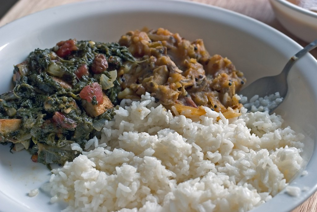 Coconut flavored rice with saag(spinach) tofu and aloo saagu (spiced mashed potatos, south indian style)