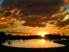 Pond Fire (jimhankey) Tags: park sunset arizona sky orange cloud sun reflection tree fall water phoenix beautiful weather topv111 wow wonderful landscape gold golden pond topv555 desert cloudy scenic naturallight sunny 2006 corona stunning vista orangesky reflectionsof dramaticsky beautifulclouds beautifulview sunray desertview eveninglight phoenixarizona waterreflection beautifulscenery afternoonlight phoenixaz cumulous scenicview orangesunset simplythebest unusuallight glowingcloud indianschoolpark orangecloud canonpowershots3is sunreflectedinwater uptownphoenix treesatsunset jimhankey arizonaweather phoenixweather phoenixariz arizonafall