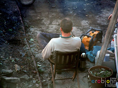 Workmen 0016 - Mark the Man plans and calculates (marmaset) Tags: blue man male men home yard work real back workmen outdoor masculine garage gang guys lad builders worker mate build tool rubble builder workie