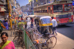 Laxmi street (wili_hybrid) Tags: street november winter india bus bicycle geotagged photo yahoo high colorful flickr dynamic photos picture pic 2006 wikipedia imaging rickshaw mapping range geotag tone pune hdr hdri photomatix tonemapped tonemapping year2006 highdynamicrangeimaging