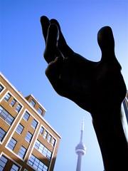 Reach Beyond (Musical Mint) Tags: city sky urban sculpture toronto canada statue architecture experimental hand cntower creative bluesky helluva topphotoblog musicalmint aplusphoto ccc1surreal