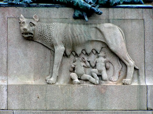 Relief of Romulus and Remus with the she-wolf on the monument in Piazza Giuseppe Garibaldi.