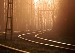 The sun sets on the tramline by the Nowa Huta steelworks - by soylentgreen23