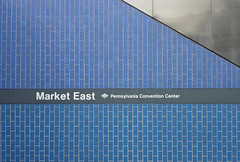 Market East (Acme Explosives) Tags: blue brick philadelphia stainlesssteel angle pennsylvania text sunday trains septa 2d marketeast prr thegallery readingrailroad pennsylvaniaconventioncenter