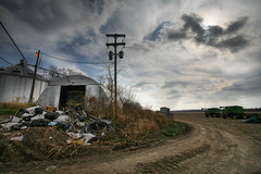 Dirt Field with Trash 11.25.2006 (Notley) Tags: road november sky fall field clouds trash rural farm 2006 powerlines agriculture telephonepole riverbottoms bocomo 10thavenue notley ruralphotography boonecountymissouri dirtfield notleyhawkins missouriphotography httpwwwnotleyhawkinscom notleyhawkinsphotography boonebounty