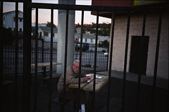 Coffee & Cigs for this Guy (TexturaObscura) Tags: sunset fountain coffee olympus xa oldguy cigs tangs forthis worstfilmever