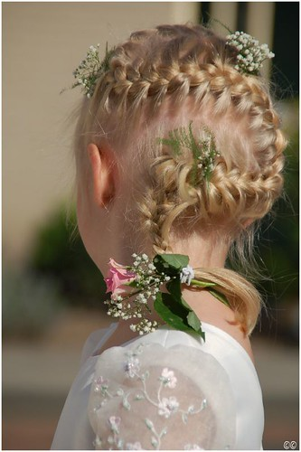 Here's a great hairstyle for your little flower girl-- a french braid that
