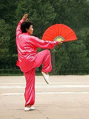 Tai Chi in the park.....Beijing, China (LA Lassie) Tags: china park morning woman taggedout outdoors fan dance exercise topv999 beijing templeofheaven taichi instructor csp inthepark august2006 views1000 lalassie top20travelportraits ysplix 10favs1032views