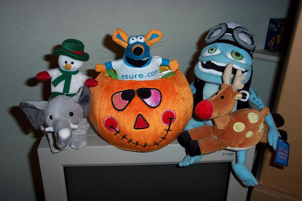 Mr Mouse sitting in a pumpkin with a snowman riding an elephant on one side and a reindeer sitting on the crazy frog's lap on the other.